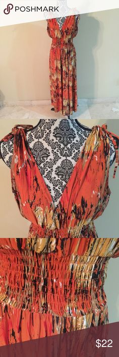 Beautiful Summer Dress It has the gathering on the top of the shoulder and has gathering around the waist as seen in the photo.  It's made of 95% Polyester and 5% Spandex. Dresses Maxi