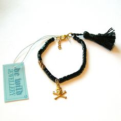 Black and gold japanese glass beads, vintage skull pendant and silk tassel.   www.dewildjewellery.etsy.com