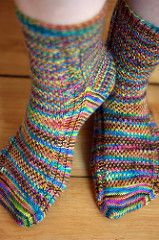 I designed this pattern to help with hand-dyed yarns that tend to pool. The slipped stitches help to break-up the visual lines and swirls and create a firm fabric. Baby cables up each side of the foot help add elasticity to the slipped-stitch pattern while the bottom of the sock is worked plain to reduce bulk on the sole of the foot.