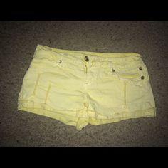 Summer time Shorts !! Yellow like new shorts. Lace on back pocket Shorts Skorts