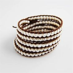 Beaded wrap bracelet from Chan Luu.  Pearl on brown leather.  I need to get my beading back on to make one of these.