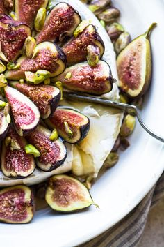 Easy Baked Brie with Figs and Honey ~ this is your ultimate Fall or holiday appetizer, but it's so rich and decadent you could even serve it for dessert!