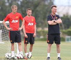 Darren Fletcher and Tom Cleverley watch on with Van Gaal as they grab a breather