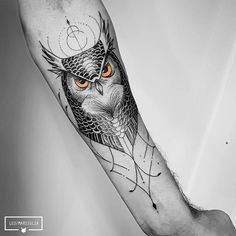 Upper right arm tattoo; the owl has blue eyes