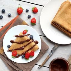 Spelt and oat flour crepes topped with homemade  hazelnut chocolate spread and berries by @hazelnutbliss by a.healthy.nut