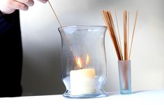 lighting a candle with a noodle stick - Google Search