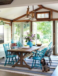 Love the table! Love the blue chairs!