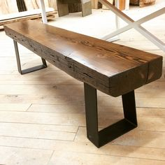 The top of this bench is made out of douglas fir, finished in kona stain. To compliment it, we added a metal flat stock base finished in flat black. This bench is one of the many custom pieces we have available in our showroom.
