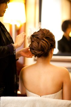 back of bride getting ready. hair do. hair updo. make up. wedding. sexy bride.  www.hilarychanphotography.com