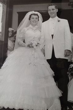 Menswear transitioned in the 1950s to a new silhouette featuring a shorter, single-breasted jacket with narrow, tapered pants. Pictured: Joan Martino and Edward O'Gorman, married on September 14, 1957.