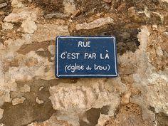 "Gimios - sign for l'Eglise du Trou (""It's That Way"" road)"