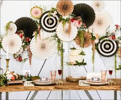 Decorate your boho shower or wedding with floral and stripes party fans! A mix of botanicals, gold foil, wood grain, polka dots and black and white stripes crea
