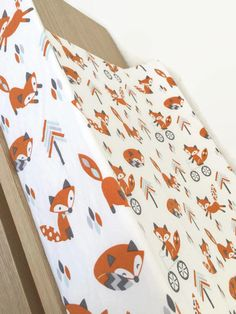 Contoured changing pad cover featuring a white fox tribal woodland print. Gender neutral and perfect for your fox themed nursery. Get the matching