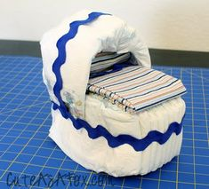 Diaper Bassinet Tutorial by cuteasafox: Darling baby shower gift! #Baby_Shower #cuteasafox #Diaper #Bassinet #DIY