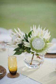 Simple white king protea centerpiece. Photo by Photography by Caspix