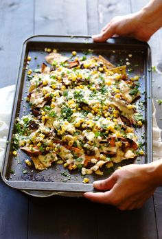 Grilled Sweet Potato Nachos: roasted corn, black beans, grilled sweet potatoes, multigrain chips, and a lightened up homemade cheese sauce.