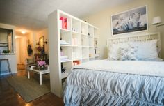 White IKEA expedit bookcase used as a room divider - Jacqueline Clair's NYC Studio Tour #theeverygirl