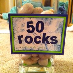 "50 Rocks...and so do you!  Great for a 50th birthday centerpiece.  Much more positive than the ""Over the Hill"" theme decorations."