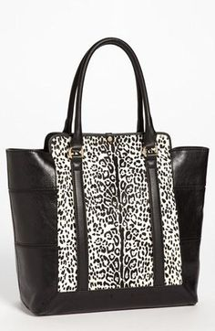 Get in my closet! Love this animal print tote.