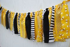 Planning a Bumble Bee party? Celebrate with the classic yellow and black re-imagined in a fabric garland. Fabric Garland, Fabric Bunting, Bee Bulletin Boards, Classroom Themes, Future Classroom, Preschool Classroom, Bee Fabric, Bee Party, Bee Theme