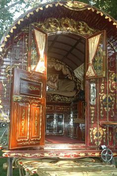 Caravan Gypsy Vardo Wagon: I am in love with the ornate woodworking!
