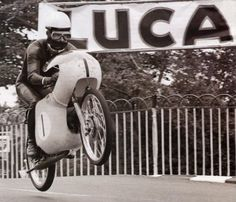 some race photos from the n race motorcycles, to get in the mood with. gettin high on race gas. European Motorcycles, Vintage Motorcycles, Vintage Cafe Racer, Vintage Racing, Valentino Rossi, Wheel In The Sky, Classic Road Bike, Death Race, 50cc