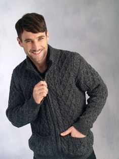 This Men's Zipped Sweater with pockets comes in stylish charcoal marl. It has the extra detail of pockets for extra comfort and a full zip. the clever use of traditional stitches in this Men's Cardigan makes this sweater not only stylish but warm. A must for any mans wardrobe.