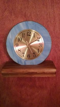 Wouldn't you love to own this lovely handmade stained glass clock. Whether you hang it on the wall or decorate your mantle in an attractive wooden stand, you will see the beauty daily for years to com
