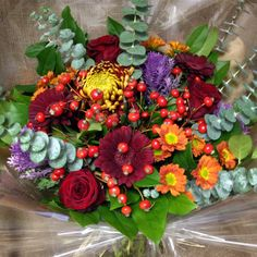 I love using autumnal colours in bouquets. Blooms, germini, chrysanthemums, roses, cabbages and rose hips are all gettin in on the act here with a mixture of gorgeous foliage too!