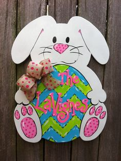 Items similar to Easter Bunny Egg LSU colors too Wooden Hand painted Door Hanger Burlap Bow on Etsy Easter Bunny Eggs, Easter Art, Easter Crafts, April Easter, Easter Decor, Bunnies, Wooden Front Doors, Wooden Door Hangers, Easter Bunny History