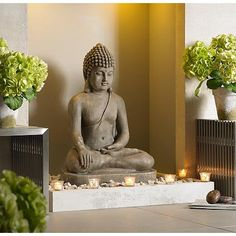 Bring a meditative Asian flair to your garden decor with this sitting Buddha outdoor statue.