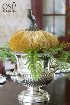 Velvet pumpkin in a lovely silver urn from onsuttonplace.com