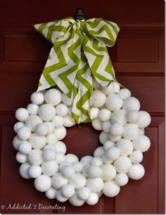 Snowball Wreath  Cover Styrofoam balls in epsom salt for a glistening snowball wreath that won't melt!