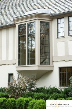 In renovating this American Tudor Arts & Crafts home, we were also mindful of how to apply landscaping to frame the architecture, a lovely bay window is always a nice detail for both settings.