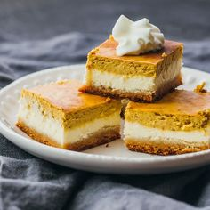 These healthy pumpkin cheesecake bars are layered with an almond crust, a cheesecake layer, and a pumpkin layer. Low carb, keto friendly, and gluten-free.