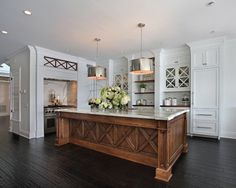 Beautiful white kitchen with wood island, brushed nickel drum pendant lighting | Fleming Distinctive Homes