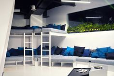 Fabulous Studio Office for Comfortable Working Daily: Excellent Bedroom Design By Ezzo Project With White Soft Bed Blue Pillows And Several Green Plants Decoration In The Windows