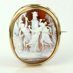 Depicting the 3 graces and cupid, this magnificent shell cameo measures 6.5cm by 5.5cm with the cameo itself measuring 5.9cm by 4.6cm.
