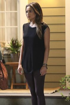 Even though, she tends to stick to sporty looks, Emily still likes to mix up her style! The chain detail on her tank and faux leather leggings give her all-black look a cool, rocker edge.