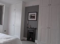 Traditional two panel shaker alcove wardrobes.