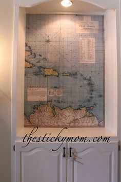 Maybe use the old map from our honeymoon road trip..background book case.