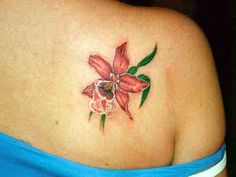 Flower Tattoo # 75 - Hot lily flower tattoo inked on shoulder back of a gorgeous babe:)