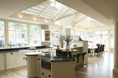 A stunning pitched roof lantern means every part of this kitchen extension has natural light. New Kitchen, Kitchen Decor, Kitchen Ideas, Sunroom Kitchen, Kitchen Dinning, Summer Kitchen, Conservatory Kitchen, Conservatory Lighting, Kitchen Orangery