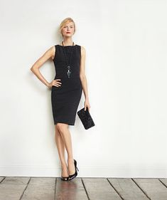 Model in a black dress | Play up your figure's best asset—your waist? your legs?—in this holiday party staple.