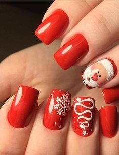 Pretty Christmas nail art. Winter nail design trends. Red and white snowflake
