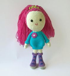 Crochet doll This cute doll will certainly make your little daughter happy. It is very nice to keep in hands. It has long hair which you can style to your own wish. It will make a perfect present for a girl. There is no wire inside, it is soft all over. The eyes are glued half-beads. Different colours are available (at request). Stuffing material: Holofiber (hypoallergenic) The doll is 22 cm (8.7) tall. Standard international shipping takes up to 20 business days.  Normal delivery time out…