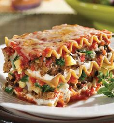 Recipe for Lasagna with Spinach - This is a filling and satisfying lasagna. Not only does it have sausage, ground beef and three types of cheese; it also has all those veggies stuffed in. With all of the other goodness, we are sure picky eaters won't mind.