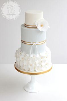 Wedding Cake Ideas: Pale Blue & Gold Trim - http://www.diyweddingsmag.com/wedding-cake-ideas-pale-blue-gold-trim/