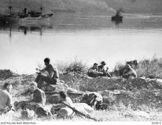 Troops on the shore of Suda Bay awaiting evacuation, April 1941 .