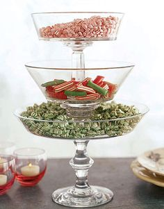 Create a tasty centerpiece for your dining table or buffet: Stack a graduated trio of footed glass compotes, secure each pedestal to the next larger with florist's putty, and fill the bowls with festive candies.